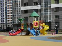 new residential buildings with a children's playground