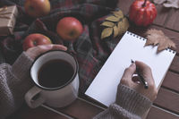autumn concept with tea and notebook