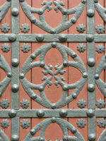 Iron fittings of an old church door in Barcelona.