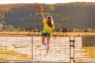 Aussie woman standing on a rural farm gate