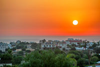 Sunset over cyprus village on sea coast