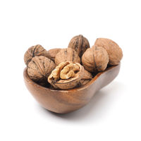 Organic French walnuts in a wooden bowl