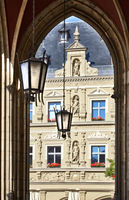 Traditional house in Erfurt, visible through the arches of Old Town Hall