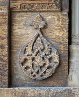 Round floral patterns framed by geometrical patterns carved into the exterior wall of Sultan Hasan Mosque, Cairo, Egypt