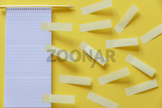 Empty notebook and yellow stickers
