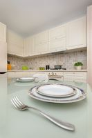 Modern beige colored kitchen and dining room