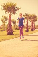 young female runner training for marathon