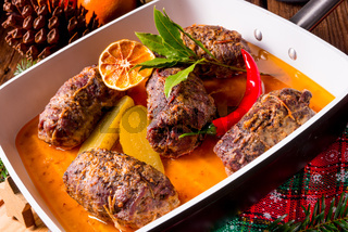 Wintry beef roulades with plum and bacon stuffing and cucumber