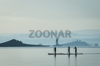 Three friends on stand up paddle boards in Firth of Forth