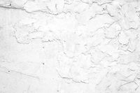 Grunge white painted rough textured wall background. Light gray texture