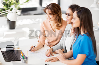 businesswomen with laptop working at office