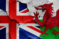flags of UK and Wales painted on cracked wall