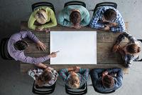 People team around blank paper
