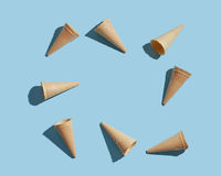 Ice cream empty cones pattern on a blue paper background. Flat lay.