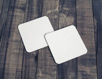 Two beer coasters