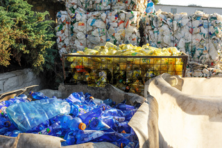Piles of compressed plastic bottles at the recycle factory