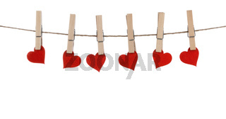 Clothes pegs and hearts on rope