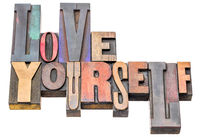 love yourself - word abstract in wood type