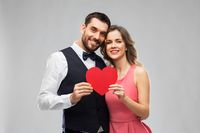 happy couple with red heart on valentines day
