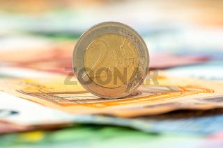 Two Euros on Euro banknotes background