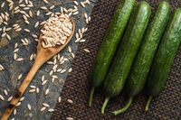 Cucumber Seeds and Melon on Blue Wooden  Background