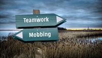 Street Sign to Teamwork versus Mobbing