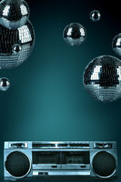Abstract background of night club disco balls and retro cassette player