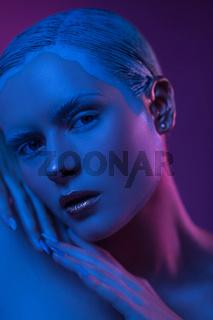 Face of High Fashion Model with Matt Skin on Purple.