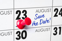 Wall calendar with a red pin - August 23