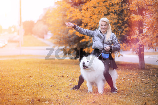 Lovely girl on a walk with a beautiful dog