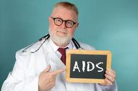 Medical Doctor holding chalkboard AIDS lettering