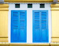 Bright blue shutters in Singapore
