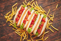 American hot dogs assorted in row. Served with french fries