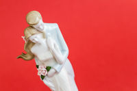 Wedding Couple Figurine on Red Background