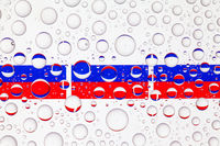 Water drops on glass and flags of Russia