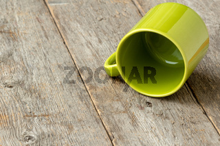 Overturned green cup
