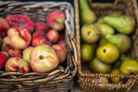Nectarines and pears in wicker basket