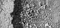 Broken road with potholes, asphalt surface destroyed. Bad road condition that needs repair. Banner size, top view. Monochrome