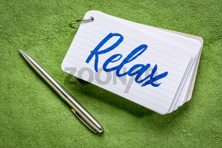 relax word on an index card