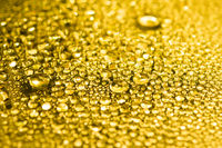 Gold water drops background