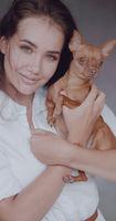 Fashion portrait of beautiful girl with dog