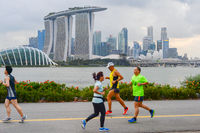 People running river Singapore Donwtown