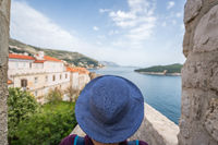 Woman in blue hat looking at Dubrovnik Old Town
