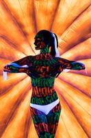 Girl with colorful UV bodyart cropped view