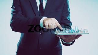 Success businessman using digital tablet show the city skyline on virtual screen