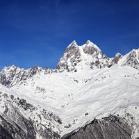 Mount Ushba in winter at sunny day