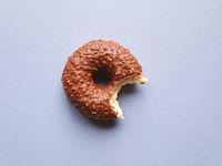 chocolate glazed donut or doughnut with bite missing