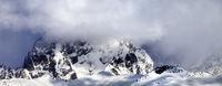 Mount Ushba in fog at sun winter day