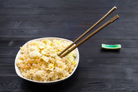portion of Fried Rice with chopstick on dark table