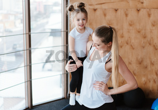 Little girl and mom posing on camera